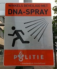dna spray road sign